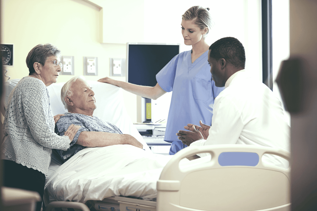 Healthcare professionales talking with elderly patient